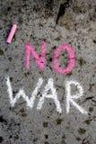 Chalk drawing: Words NO WAR. Colorful chalk drawing on asphalt: Words NO WAR stock photos