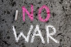 Chalk drawing: Words NO WAR. Colorful chalk drawing on asphalt: Words NO WAR stock image