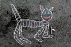 Colorful chalk drawing: funny cat. Colorful chalk drawing on asphalt: funny cat stock photography