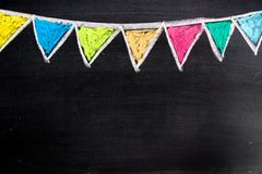 Colorful chalk drawing in hanging party flag shape. On blackboard background Royalty Free Stock Images