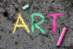 Chalk drawing : Word ART and pieces of chalk. Colorful chalk drawing on sidewalk: Word ART and pieces of chalk royalty free stock photography