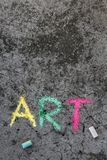 Chalk drawing : Word ART and pieces of chalk. Colorful chalk drawing on sidewalk: Word ART and pieces of chalk royalty free stock image
