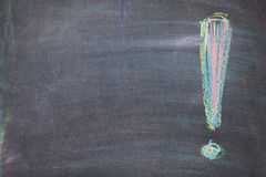 Colorful chalk exclamation mark on blackboard background Stock Images