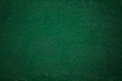 Colorful chalk on green chalkboard Stock Photography