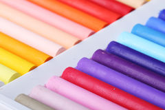 Colorful chalk pastels in box close up Royalty Free Stock Images