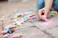 Colorful chalk on the pavement Stock Photos