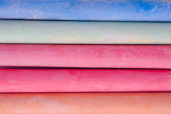 Colorful chalk on a white background. Royalty Free Stock Photo