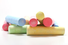 Colorful chalks. On white background stock images