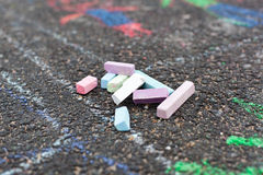 Colorful chalks on asphalt Royalty Free Stock Images