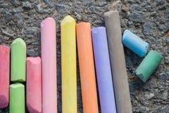 Colorful chalks. On asphalt background Royalty Free Stock Photo