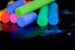 Colorful chalks on black background Stock Photo
