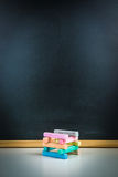 Colorful chalks and blackboard Royalty Free Stock Photo