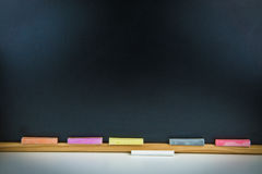 Colorful chalks and blackboard Royalty Free Stock Photography