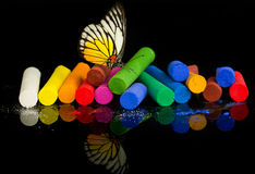 Colorful chalks with butterfly Stock Photos