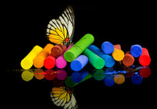 Colorful chalks with butterfly Stock Photography