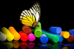 Colorful chalks and butterfly Royalty Free Stock Photography