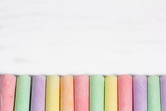 Colorful chalks in a row Stock Photography