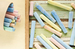 Colorful chalks on table Stock Photo