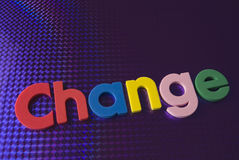Colorful change word on blue neon background Royalty Free Stock Photography