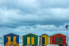 Colorful changing rooms in St James beach Cape Town royalty free stock photography