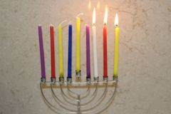 Colorful Chanukah candles lit in the menorah, candle light Royalty Free Stock Photos