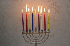 Colorful Chanukah candles lit in the menorah, candle light Stock Images