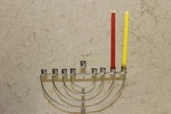 Colorful Chanukah candles lit in the menorah, candle light Stock Photography