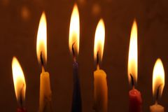 Colorful Chanukah candles lit in the menorah, candle light Royalty Free Stock Photography