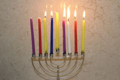 Colorful Chanukah candles lit in the menorah, candle light Stock Image