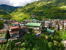 Colorful chaotic buildings in front of the rise terraces Banaue, Philippines. stock photo