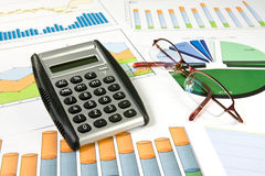 Colorful  charts, calculator and glasses Royalty Free Stock Photo