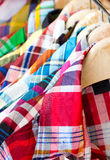 Colorful Checked Shirts With Hangers. Stock Photo