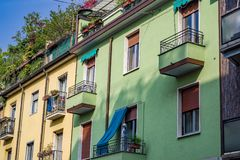 Urban life on display in Milan, Italy with cheerful colors, inviting rooftops and balconies. Royalty Free Stock Photos