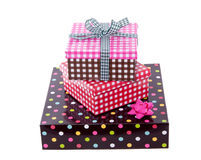 Colorful and cheerful gift boxes. With a ribbon isolated over white Stock Images