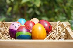 Colorful fancy easter eggs in wooden box. Colorful, cheerful, vibrant fancy easter eggs in wooden box Royalty Free Stock Photography