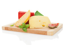 Colorful cheese assortment on chopping board. Royalty Free Stock Photos