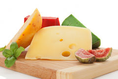 Colorful cheese variation on cutting board. stock photo