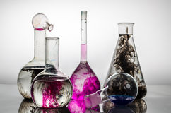 Colorful chemistry. Chemistry glasses filled with color ink in  water Stock Photo