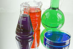 Colorful chemistry glassware Royalty Free Stock Photos
