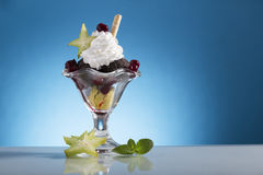 Colorful cherry Sundae with wipping cream and Carambola decorate stock photos