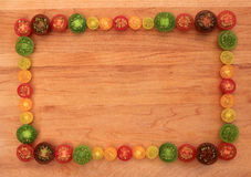 Colorful cherry tomato frame Royalty Free Stock Photo