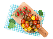 Colorful cherry tomatoes on cutting board Stock Image