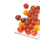Colorful cherry tomatoes on white board Royalty Free Stock Photo