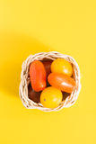 Colorful cherry tomatoes in wicker basket Royalty Free Stock Images