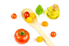 Colorful cherry tomatos on wooden spoon Royalty Free Stock Photo