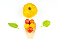 Colorful cherry tomatos on wooden spoon Stock Images