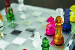 Colorful chess on the glass board.  Stock Photo