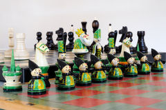 Colorful chess pieces on wood board Royalty Free Stock Photography