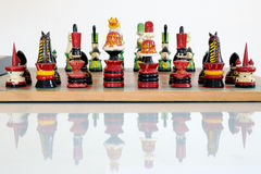 Colorful chess pieces on wood board Stock Photography