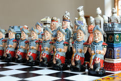 Colorful chess pieces on wood board Royalty Free Stock Image